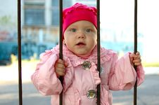Free Little Girl Behind Old Railing (grille). Royalty Free Stock Photos - 6604588