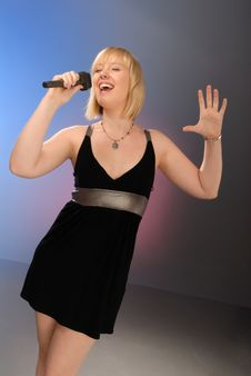 Free Cute Blond Girl Singing Stock Photography - 6607422