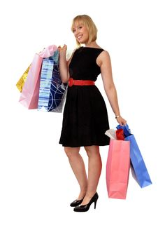 Attractive Blond Girl With Colorful Shopping Bags Royalty Free Stock Photography