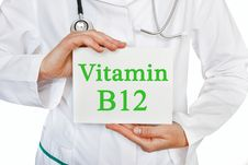 Vitamin B12 Written On A Card In Doctors Hands Royalty Free Stock Image