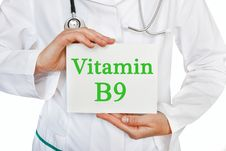 Vitamin B9 Written On A Card In Doctors Hands Stock Photo
