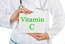 Vitamin C Written On A Card In Doctors Hands Royalty Free Stock Photos