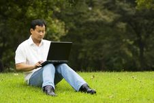 Free Man Using A Laptop Outdoors Royalty Free Stock Photo - 6610725