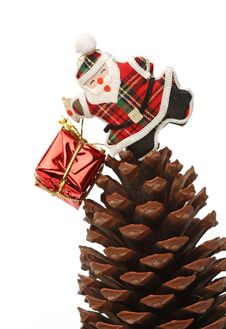 Free Santa With Gift Box Over A Pine Cone Stock Photo - 6610890