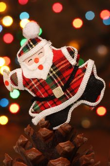 Santa With Gift Box Over A Pine Cone Stock Photography