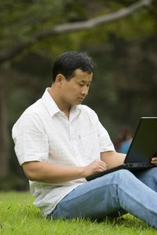 Free Man Using A Laptop Outdoors Stock Images - 6611744