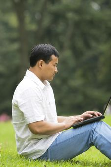 Free Man Using A Laptop Outdoors Royalty Free Stock Image - 6612676