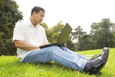Free Man Using A Laptop Outdoors Stock Images - 6612744