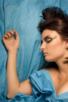 Woman Sleeping In Blue Bedclothes Stock Photo