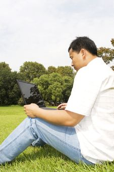 Free Man Using A Laptop Outdoors Royalty Free Stock Photo - 6616355