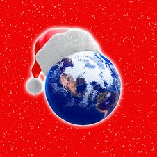 Earth Globe And Santa Hat Stock Photography