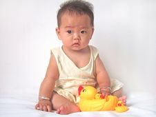 Pretty Baby And Toy Ducks Royalty Free Stock Image