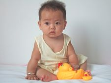 Pretty Baby And Toy Ducks Royalty Free Stock Photos