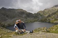 Happy Couple At Mountain Lake Royalty Free Stock Photo