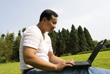 Free Man Using A Laptop Outdoors Royalty Free Stock Images - 6617729
