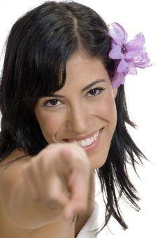 Pointing Woman Looking At Camera Royalty Free Stock Photos