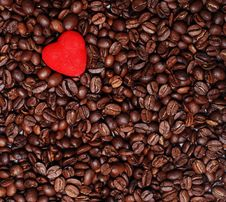 Red Heart And Coffee Seeds Royalty Free Stock Photos