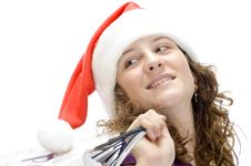 Free Female With Carry Bags And Santa Cap Stock Photography - 6619022