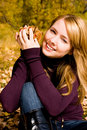Free Pretty Girl With Yellow Leaves In Her Hands Royalty Free Stock Photography - 6627077