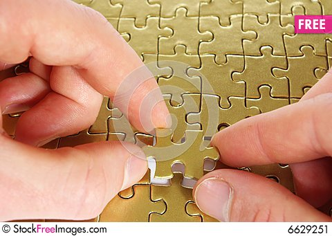 Free Puzzle In Hands Stock Image - 6629251