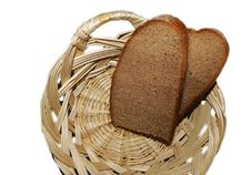 Pieces Of Bread In A Small Basket Stock Photography