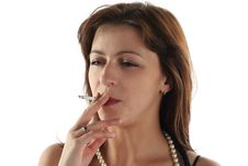 Woman Is Smoking Royalty Free Stock Photography