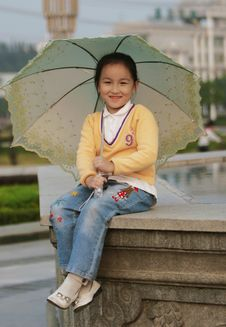 Free Smiling Girl With A Umbrella Stock Photo - 6622540