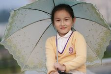 Free Smiling Girl With A Umbrella Stock Photography - 6622552