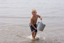 Free Boy Carrying Bucket Royalty Free Stock Photo - 6622615