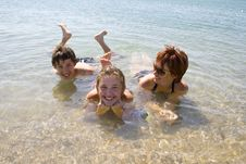 Children With Mother On The Beach Stock Photos