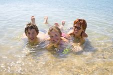 Children With Mother On The Beach Royalty Free Stock Photography