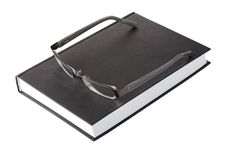 Free Glasses On A Book Stock Photo - 6625550