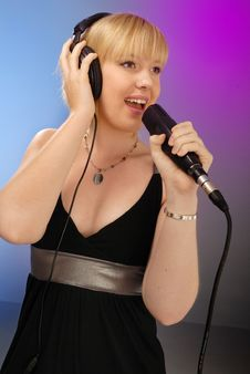 Free Cute Blond Girl Singing Royalty Free Stock Photos - 6626348