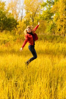 Free Happy Girl Jumping In The Park Royalty Free Stock Image - 6627086