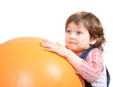 Free Little Girl Playing With Big Orange Ball Royalty Free Stock Photos - 6630158
