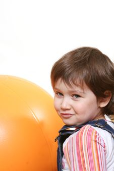 Free Little Girl Playing With Big Orange Ball Royalty Free Stock Image - 6630186