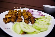Satay With Cucumber And Onions Stock Photos