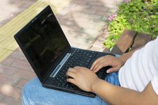 Man Using A Laptop In The Park Royalty Free Stock Photography