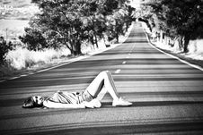 Free Girl Laying On The Road Stock Photos - 6634113