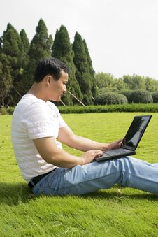 Free Man Using A Laptop Outdoors Royalty Free Stock Photo - 6634435