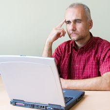 Thoughtful Office Worker Royalty Free Stock Image