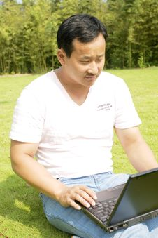 Free Man Using A Laptop Outdoors Stock Photography - 6635262
