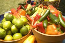 Free Bowls Of Limes And Peppers Stock Image - 6635551