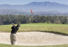 Golfer Hitting Out Of Sand Trap Royalty Free Stock Images