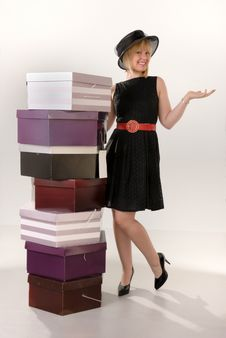 Free Attractive Blond Girl With Hat Boxes Royalty Free Stock Photography - 6639427