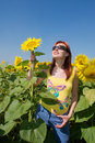 Free Red-hair Ukrainian Girl Holds A Sunflower Royalty Free Stock Image - 6644306