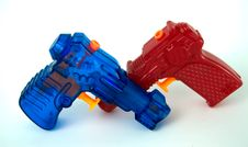 Free Red And Blue Water Pistols Royalty Free Stock Images - 6641059