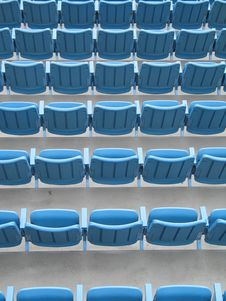 Free Blue Aligned Plastic Chairs Stock Photos - 6642573