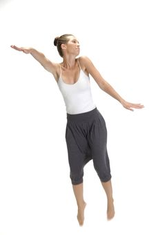 Free Jumping Woman Stretching Her Arms Stock Image - 6643641