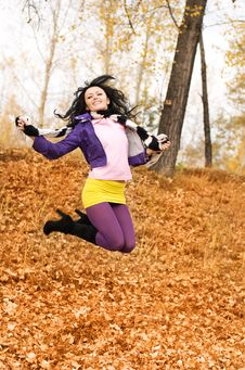 Free Happy Jumping Girl In The Park Stock Photo - 6644050